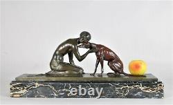 J Lormier, Femme assise au lévrier, bronze art déco signé, XXème siècle