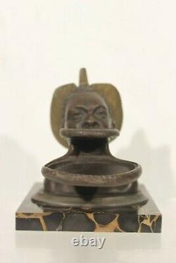 M. Leducq Bronze patiné sujet africaniste Mursis femme au plateau Art Déco