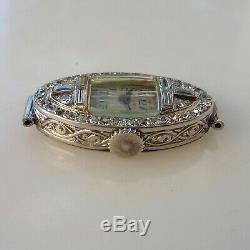 Magnifique montre Longines art déco en platine sertie de 46 diamants
