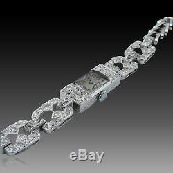Montre dame Art déco en platine 1930 avec diamants taille ancienne. Mécanique