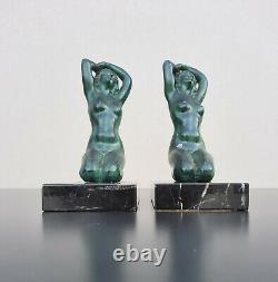 Paire de serre-livres métal patiné femmes nues terrasse en marbre style Art Déco