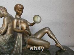 Sculpture art deco LIMOUSIN femme nue homme faune statue en regule patine bronze